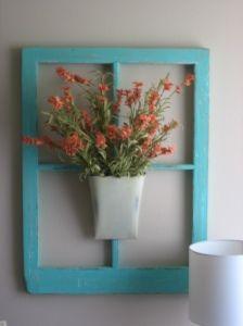 Refurbished window with flower bucket.