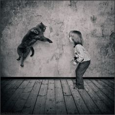 Russian photographer Andy Prokh created a series of back and white photography – Little Girl and Tomcat.