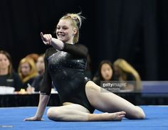 Denver's Claire Hammen gestures as she ends her floor routine during semifinal I of the NCAA Women's Gymnastics National Championship on April 14, 2017, at Chaifetz Arena in St. Louis, MO.
