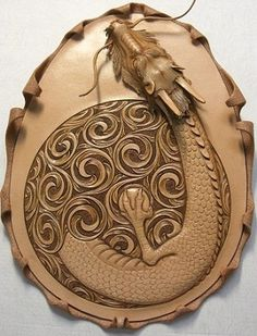 Dragon Egg leather tooled from http://www.shop-cram.com/information/workshop/workshop.html