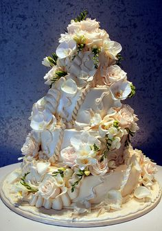 Wedding Cake with fresh flowers and icing ribbons flowing around the cake