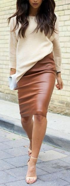 Cream sweater and tan leather skirt