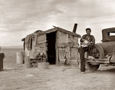 Migratory Mexican field worker's home next to pea field. Imperial Valley, CA, by Dorothea Lange 1937