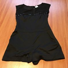 ♥️Flash Sale♥️ Free People Romper Gorgeous black romper.. Size 8.. Is a reposh... It was a little too sort for me..  I believe it runs a little smaller Free People Other