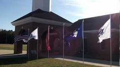 Service Flags flying in front of our church for Memorial Day and Veterans Day.