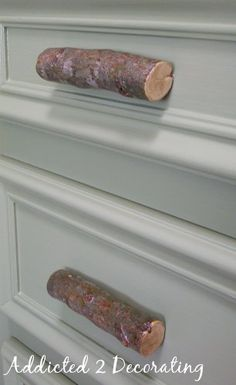 Drawer pulls made out of cut tree branches. I heart rustic decorating, especially when it is free!