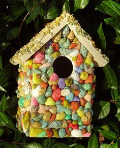 Dyed Shell Bird House, Roof is covered with teeny pebbles in subtle shades of sage, beige, and ochre.