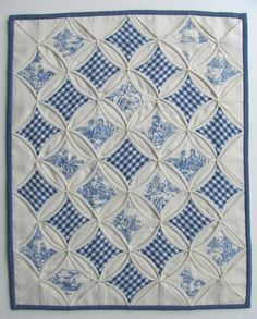 gingham quilt in white and blues ... there is a die cut plate that cuts this pattern ... great inspirations ...