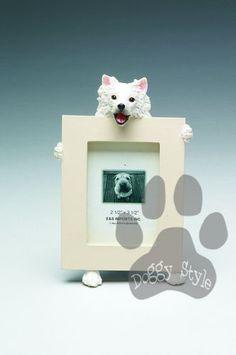 American Eskimo Dog Holding Picture Frame