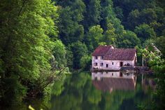 """Le Mirror de Scey"". We kayak right through this picturesque spot on our Best Kept Secrets of the French-Swiss Borderland sojourn. It feels magical --like we are in a painting by Courbet.(http://www.sojournertours.com/east-france-adventure-tour/)"