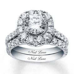 This Neil Lane bridal set in 14 karat white gold features a cushion cut center double halo engagement ring with a matching diamond wedding band. Neil Lane Bridal Set, Bridal Sets, Diamond Wedding Bands, Wedding Rings, Camo Wedding, Bridal Rings, Bridesmaid Jewelry Sets, Bridal Jewelry, Rhinestone Jewelry