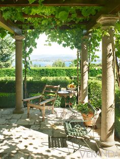 A gravel terrace is bordered by boxwood and agapanthus in this Lake Geneva garden. Photo by Alexandre Bailhache. From Veranda.
