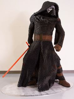 LEGO Kylo Ren built for Star Wars: The Force Awakens premiere. Made from 28,826 bricks over 260 hours, the model weighs in at 192 pounds and stands 70 inches tall.