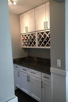 Display your wine collection proudly in your Wolf Classic Cabinetry! It's incredibly durable and the perfect addition to any kitchen design. Learn more on our website. #TimelessKitchenDesign #CustomWineCabinets #ClassicKitchenDesign