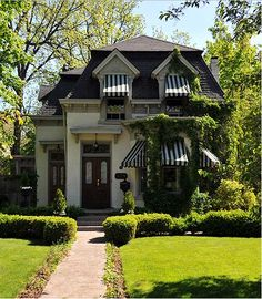 Charming and enchanting home | The landscaping fits well with the exterior of this lovely home.