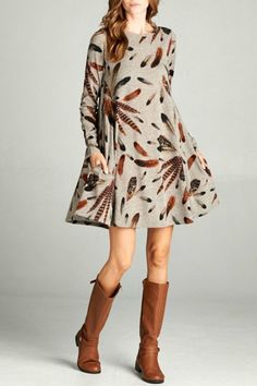 Light weight sweater shift dress with bold feather print. This dress can be worn as a dress or tunic with jeans or leggings and boots. Dress/tunic Knit Print by Bellamie. Clothing - Dresses - Long Sleeve Mississippi