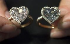Pair of fancy coloured heart-shaped diamond rings during an auction preview at Christie's in Geneva. Can I have one please? Just one?