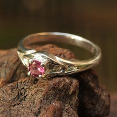 Faceted pink tourmaline gemstone ring with sterling silver band