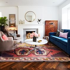 I love the rosy pink accents in this room...so nice against the warm wood tones.