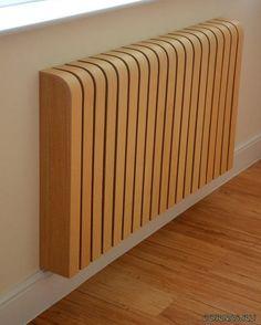 Красивый экран для радиатора украсит любую комнату.