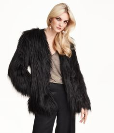 Jacket in faux fur. Hook-and-eye fastener at front, side pockets, and satin lining.