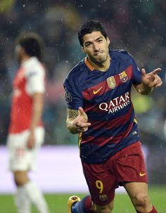 Barcelona's Uruguayan forward Luis Suarez celebrates a goal during the UEFA Champions League Round of 16 second leg football match FC Barcelona vs Arsenal FC at the Camp Nou stadium in Barcelona on March 16, 2016.