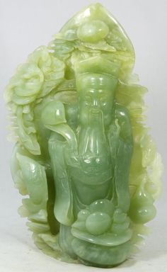Hand carved Chinese apple green deity jade group figure.