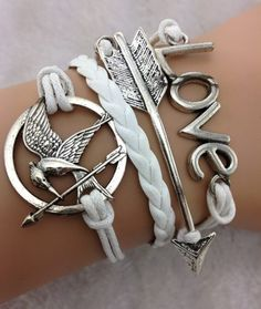 Hunger Games themed bracelet. The nerd in me wants this REAL bad....