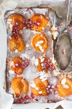 Flourless almond - honey cake w/sesonal fruits...5 eggs (seperated,yolks + whipped whites w/pinch salt)...1/3 c sugar...1/2 c honey...125 g butter, softened...2 c very finely ground almonds...0.5 kg apricots...1 handful of red currants...after baking sprinkle with vanilla sugar