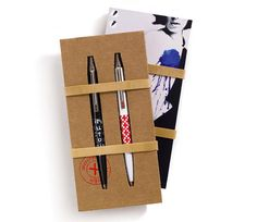 pens for signing on the dotted line -- rubber band wrap