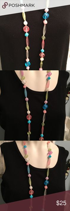 "Single strand 54"" Pastel Bead Flapper Necklace Early plastic long strand necklace 54"". Pastel beads in various shapes and colors. So pretty!  This is from my moms collection of vintage jewelry. unbranded Jewelry Necklaces"