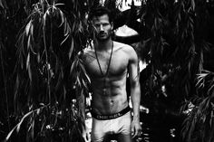 Provocative dark images of David Koch by Sebastian Hilgetag shooting in Berlin. The model is posing provocative in white trunks by Diesel outdoors while Hilgetag capture every moment.