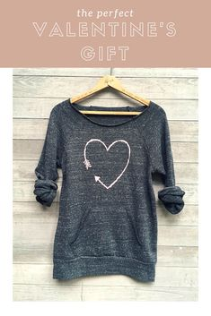 This adorable sweater would make the perfect Valentine's Day gift for someone special - something they can use all year round! || i love you more Heart Sweatshirt, Valentine's Day Gift, Girlfriend Gift, Cozy Sweater, Anniversary Gift  #ad #sweater #cute #valentinesday #love #adorable #valentines #gift #giftforher #heart #pint #grey #cosy #winter