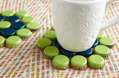 DIY bottle cap coasters & 9 other bottle cap craft ideas At Homemade Simple… Bottle Cap Coasters, Beer Bottle Caps, Bottle Cap Art, Beer Caps, Plastic Bottle Caps, Bottle Cap Table, Bottle Cap Necklace, Glass Coasters, Reuse Bottles