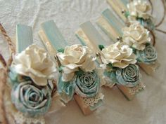 Shabby Chic Cottage blue and ivory decorated clothespins decorative clothes pegs Set of 8 with paper flowers. $18.00, via Etsy.