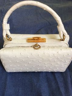 """Koret OSTRICH white Handbag.... a lovely white ostrich with a """"Hermes"""" orange leather interior. Complete with original mirror and coin purse."""