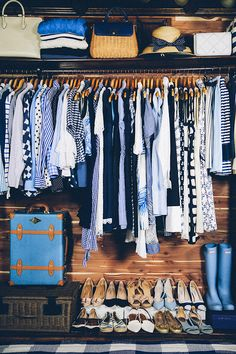 Navy & White color coordinated closet