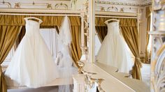 Wedding dress hanging in the Rococco suite of Gosfield Hall. Photography by Enchantingwood.  http://www.enchantingwood.co.uk/gosfield-hall-wedding-photographer/