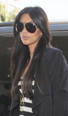 Kim Kardashians sleek and shiny hairstyle