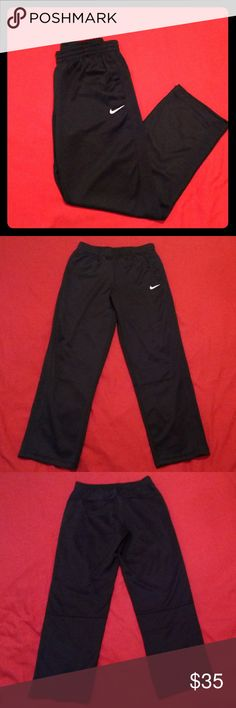 Nike Striker Track Pants Nike striker track pants. Made for men but, should fit women just fine!  -Size Medium -Two front pockets & one back pocket with velcro closure -Drawstring inside -Thick black stripe on sides -Never been worn(tag came off & I threw it away) -100% polyester  Any questions, let me know! Nike Pants Sweatpants & Joggers