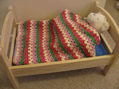 Granny Stripe Doll Blanket tutorial.  Looks like the Ikea bed.  Very clear instructions, including how to finish it off.