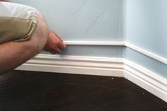 TA-DA!!!!!! Chunkier baseboards!!!!!!  With about $6 worth of tiny trim above the small existing baseboard, then painted to all look like one piece.  Isn't that SO GREAT!I think so!  Seriously, the molding for just this nook only cost like $6 bucks!  Do you LOVE that!?!
