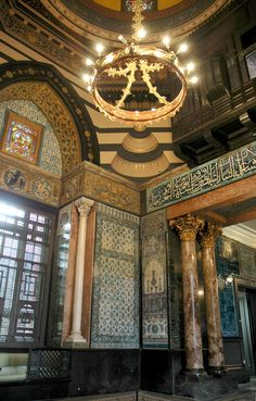 Arab Hall, Leighton House Museum is the former home of Victorian artist Frederic, Lord Leighton (1830-1896).  The Arab Hall with its golden dome, intricate mosaics and walls lined with beautiful Islamic tiles.  Leighton lived alone in his palace, occupying the house's only bedroom on the first floor. It is open to the public and located on Holland Park Road, London, England.