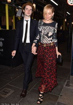 Wild thing: Sienna Miller wore an eye-catching animal-print skirt and eclectic top as she ...