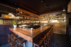This recently opened Lower East Side spot is helmed by former Pegu Club barman Kenta Goto and features a menu inspired by Japanese cruisine. The intimate space, designed by Wilkinson Architects, is simple and refined, with dark floors, walls, and ceilings and warm wood bar lit at night with a golden glow. 245 Eldridge Street, New York; bargoto.com