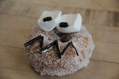 Easy to make at home - decorate a coconut donut from Dunkin' w/ marshmallow & chocolate chip eyes and a licorice mouth 'glued' on w/ frosting!