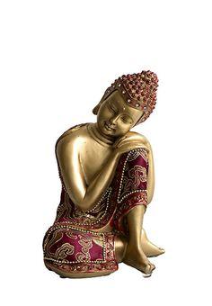 Handmatig uit polystone gegoten kleine slapende boeddha urn of Indische Buddha urn uit eigen import, met zo'n 0.7 liter inhoud, voor een deel van de as van een geliefde (of alle as van een klein kind of baby). De goud-rode bekleding met sierstiksel is gemaakt van echte, zachte stof. In de ietwat verweerde hoofdtooi zitten 9 diamant geslepen glazen steentjes. Deze kleine urn heeft een afsluitbare en verlijmbare vulopening aan de onderzijde, met een dopje