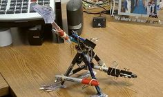 Make a Tyrannosaurus Rex out of pens and clamps.