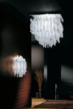 Collection from AXOLIGHT consisting of wall lamps, ceiling lamps and suspended lamps with double-layered coloured Murano glass hand twisted pendants. Available in several colours and sizes. Ceiling Lamps, Wall Lamps, Toronto Canada, Lamp Design, Murano Glass, Small Spaces, Surface, Chandelier, Pendants