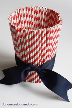 Red paper straws around a silver bucket tied with a navy bow.  Cute and easy!